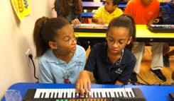 kids playing piano